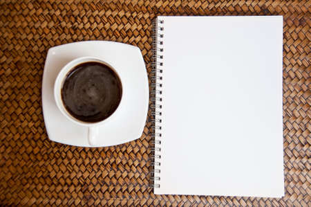 blank paper and black coffee on sedge background photo
