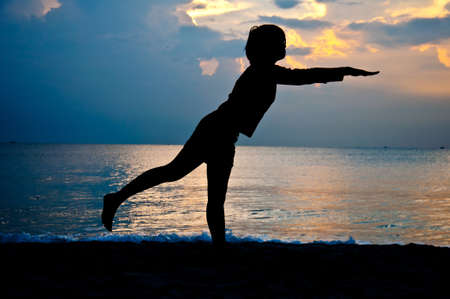 silhouette of girl yoga exercise   on the beach Stock Photo - 13143883