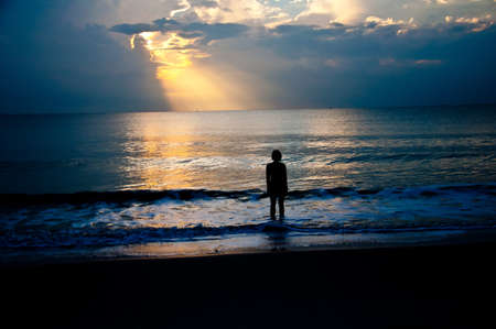 silhouette of girl look for hope in the sea