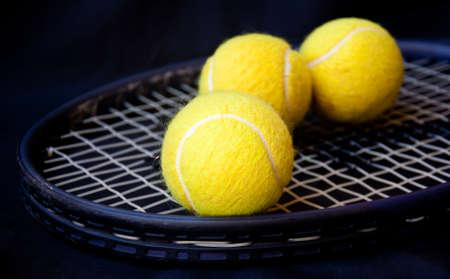 tennis ball on racket photo