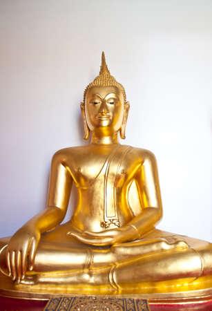vertica: golden Buddha statue in the temple