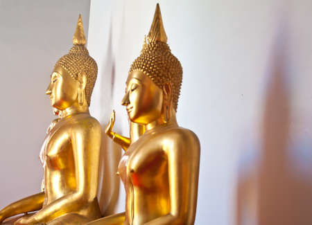golden Buddha statue in the temple photo
