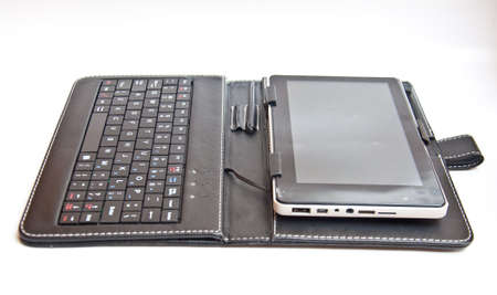 tablet pc  and leather wallet on white background Stock Photo - 13814212