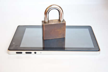 tablet pc  and lock on white background photo