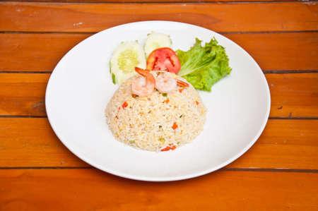 Fried rice with shrimp on wood photo