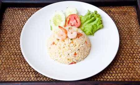 Fried rice with shrimp on sedge background photo