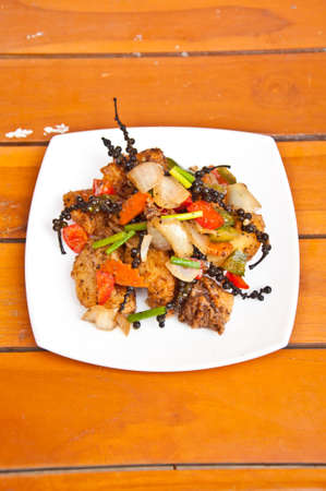 fried fish with chili pepper photo