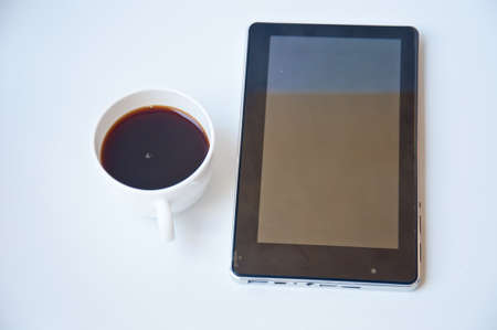 Black coffee and tablet PC on white background photo