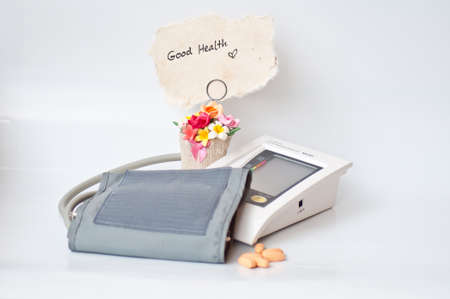 sphygmomanometer and drug on white background photo