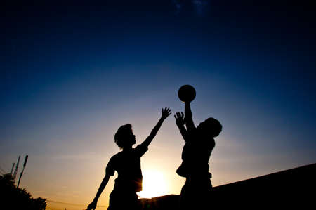 silhouette of man playing basketball photo