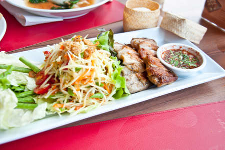 delicious Thai food call SOMTAM and grill chicken with stricky rice photo