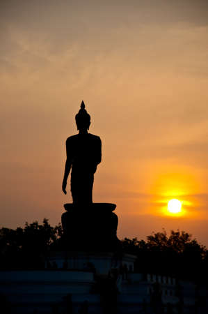 standing Buddha statue photo