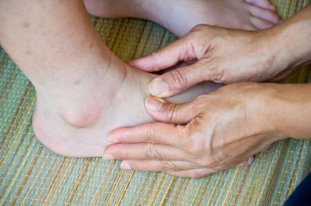 foot massage for alternative medicine Stock Photo - 23789583