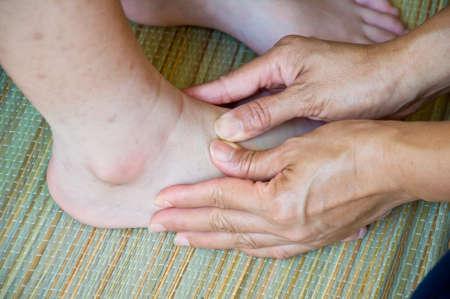 foot massage for alternative medicine Stock Photo - 23789583