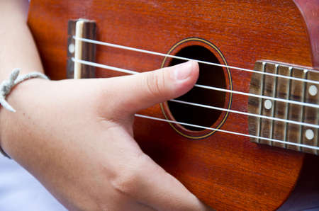 hand from children for play Ukulele Stock Photo