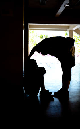 silhouette of boy helping friend from sad and depress photo