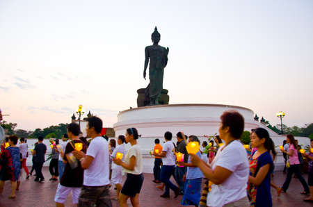 14 feburay 2014unidentified people in Makhabucha, Buddhism Candle Ceremony, Walk with lighted candles in hand around Buddha statue on 14 february 2014 Nakhonpratom province