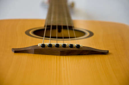 fingerboard: six string of acoustic  guitar background Stock Photo