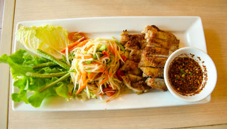 roasted chicken with delicious Thai food call SOMTAM photo