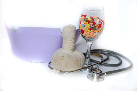 compress ball herbal with medicine and stethoscope photo