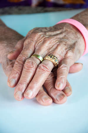 old woman hand with wedding ring Stock Photo