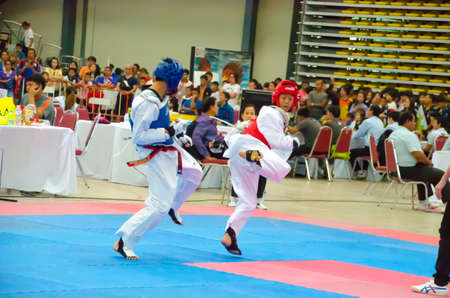17 years: BANGKOK, THAILAND - APRIL 4 : Unidentified Thai students 4 - 17 years old in action at GH BANK  Taekwondo championship 2015 on April  3-6, 2015 in Bangkok , Thailand