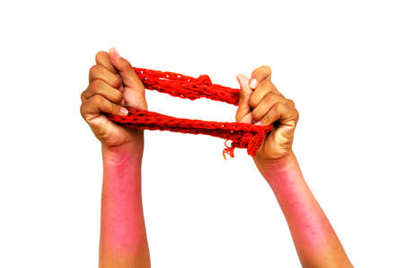 inflammatory: hand and arm exercise with elastic resistance band on white background with red inflammatory