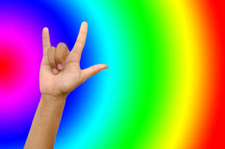 hand from children for love on multicolor  background