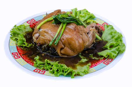 delicious Thai food call KHAMOO from boiled pork with herbal ingredient and vegetable on white background