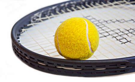 tennis ball on racket on white background