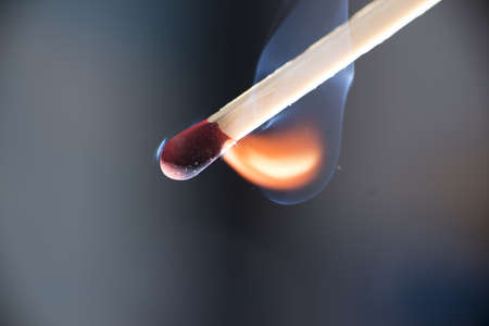 ignited: Match stick at Moment of ignition, macro with flame and smoke