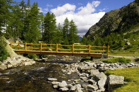 A yellow bridge on the river Stock Photo