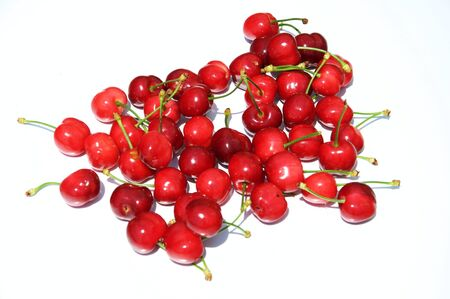 Red cherries isolated on white background Stock Photo