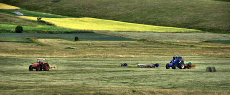 Farmer on his tractor plowing the field, rural wyoming