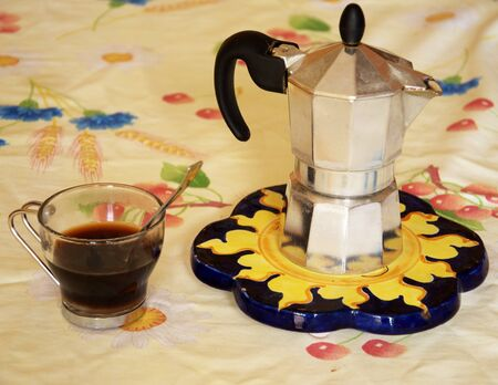 percolator: Coffee percolator and a cup of coffee on the table Stock Photo