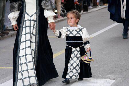 velvet dress: Little girl with velvet dress during the Velvet Horserace in Leonessa