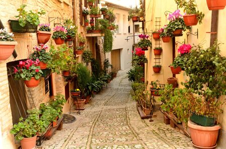 Middle age  Renaissance stone built houses in Umbria Italy downhill