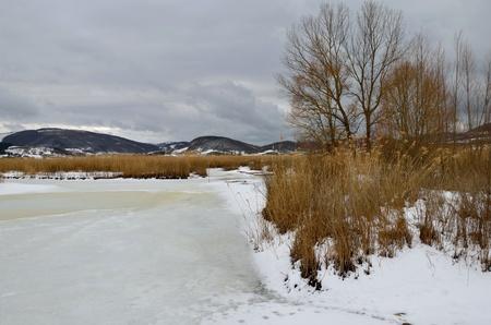 Frozen Colfiorito lake in the winter photo