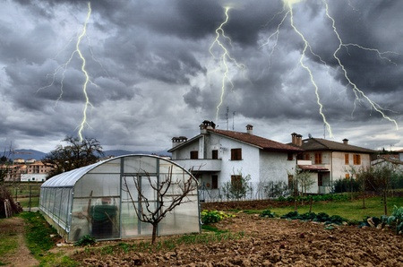 Lightning bolt over country village photo