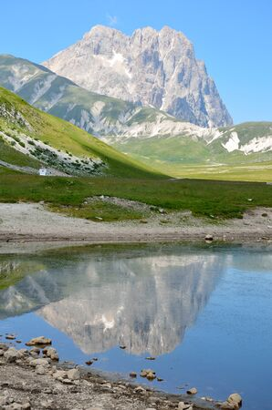 The reflect of the Gran Sasso on the blue lake Stock Photo
