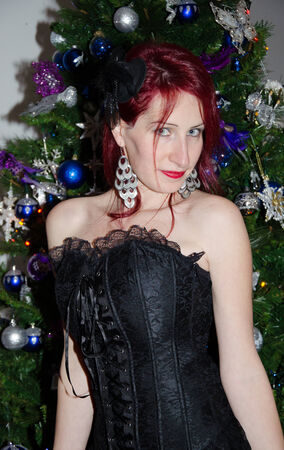 gothic woman: Portrait of gothic woman near the christmas tree Stock Photo