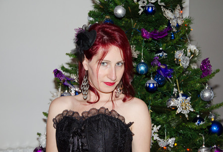 Red woman near the christmas tree photo