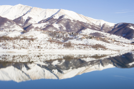 reflects: The reflects of the white mountains in the lake
