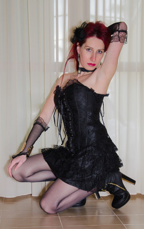 Model wearing black corset and skirt photo