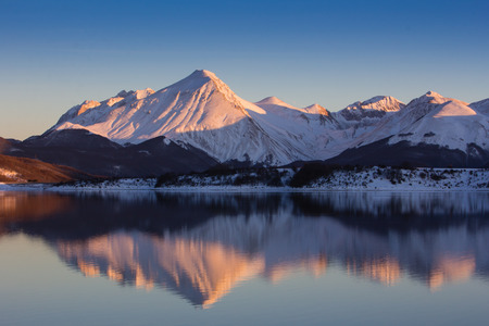ice dam: The reflects of the mountains in the lake