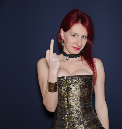 indecent: Aggression. Portrait of Crazy Woman Rocker Showing her Middle Finger - Fuck Sign. Provocation Concept Stock Photo