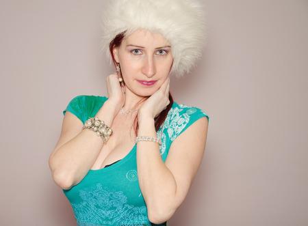 Beautiful woman with white ushanka Stock Photo