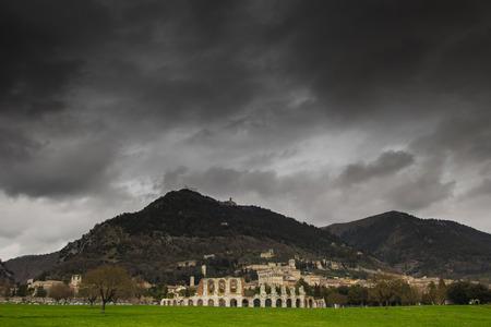 Dark storm over Gubbio city in Umbria photo