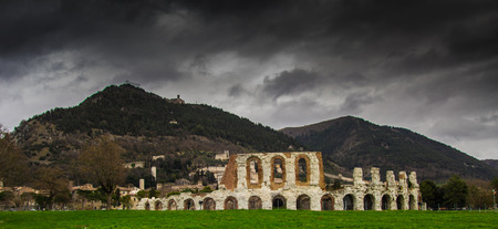 Panoramic view of Gubbio town on cloudy day in Umbria - Italy. photo