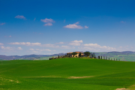 val d'orcia: Tuscany landscape with typical farm house on a hill in Val d\